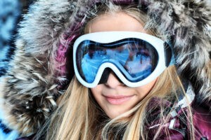 Top wireless ski gear for music on the hill, closeup girl goggles.