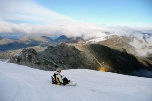 Snowboarder taking in the views at Coronet Peak, New Zealand