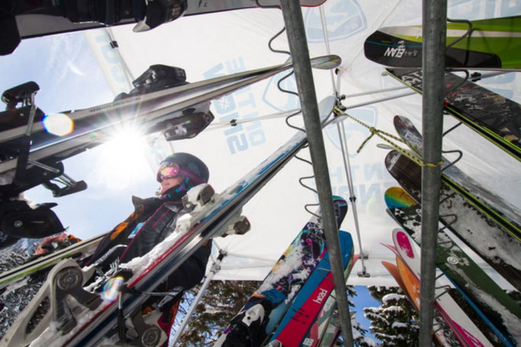 Skis on rack of different lengths.