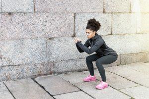 woman training exercise squatting.