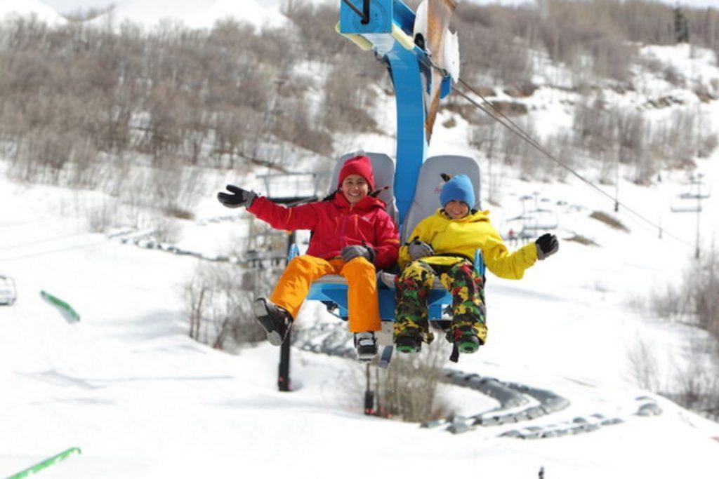 Kids enjoying the ride up aboard Flying Eagle