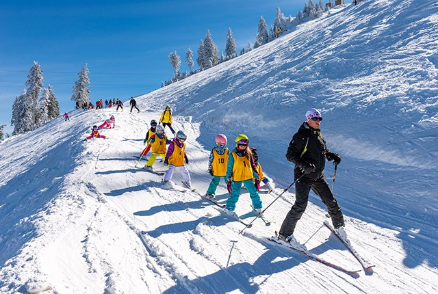 Ski school confidential instructor with kids