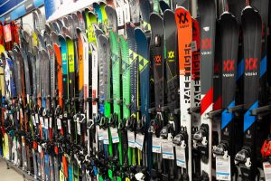 Skis linked on the wall of a ski shop
