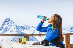 Woman drinking water mountains