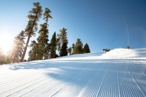 Spring skiing means fewer lift and more groomer (and tan) lines.