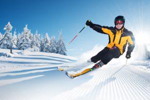 Man skiing yellow jacket how to demo skis correctly