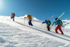 Skiers_hiking_up_mountain_gear