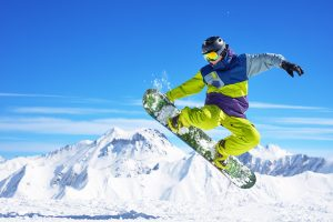 male snowboarder in action air