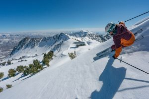 A woman skis in soft snow.