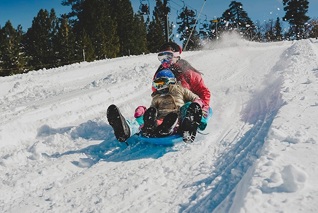 Sledding at Snow Valley Mountain Resort, CA.